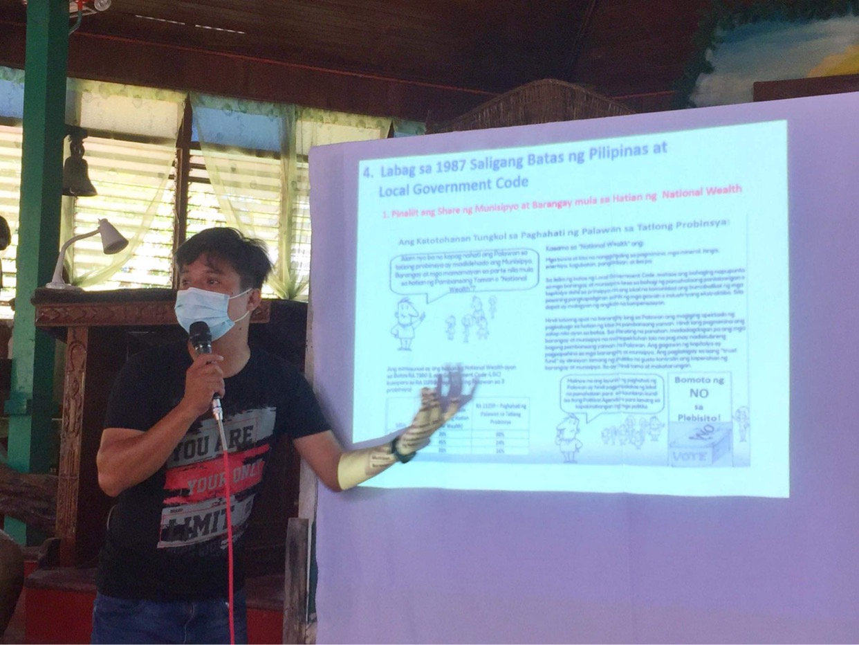 Mike Ollave in San Isidro Labrador Parish in Port Barton, San Vicente conducting an IEC activity for One Palawan
